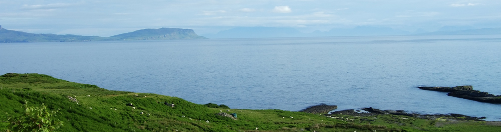 Islands of Eigg & Skye from Air an Oir Ardnamurchan Scotland