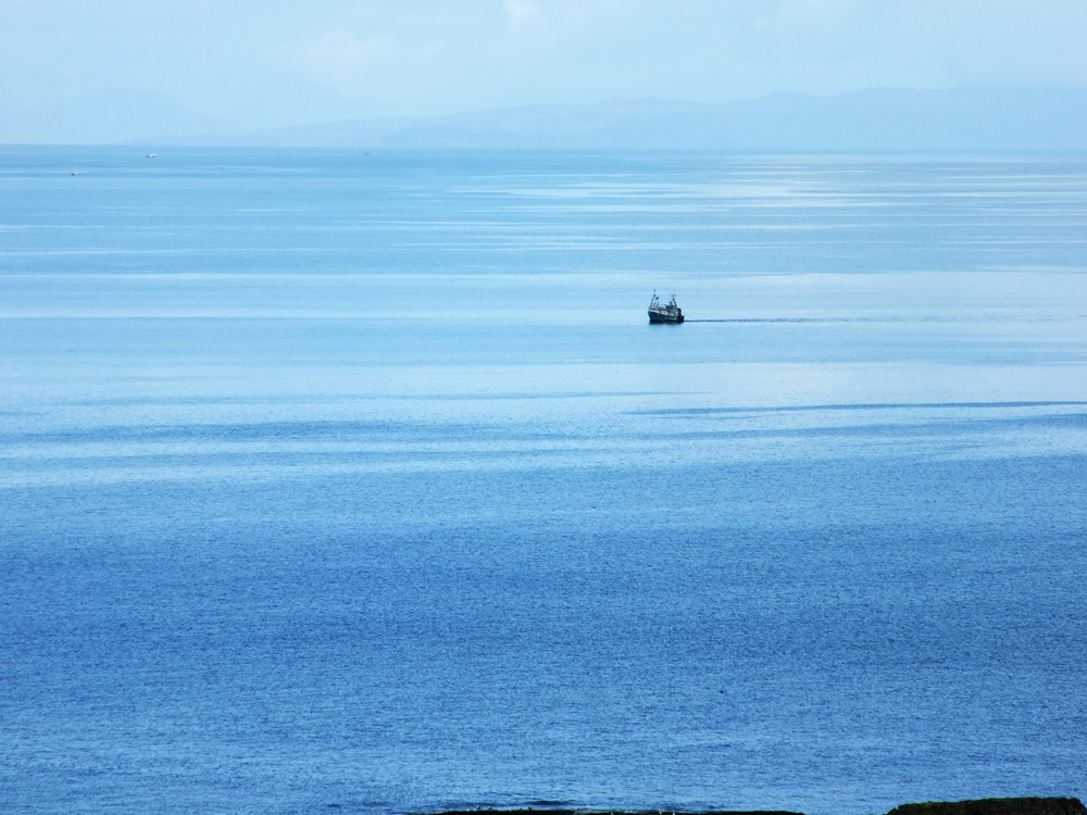 Fishing boat in sea - view from Air an Oir self catering Ardnamurchan