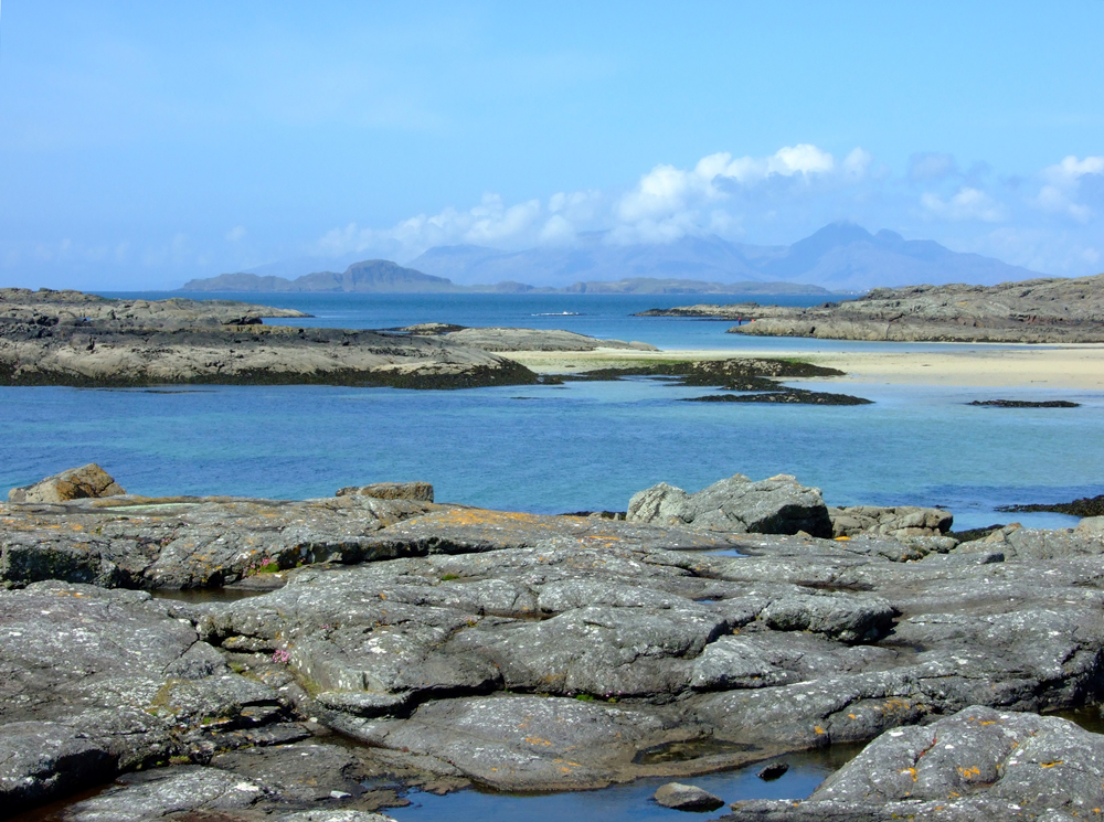 Views of the islands of Eigg Rhum & Muck from the beach near Air an Oir self catering in Ardnamurchan